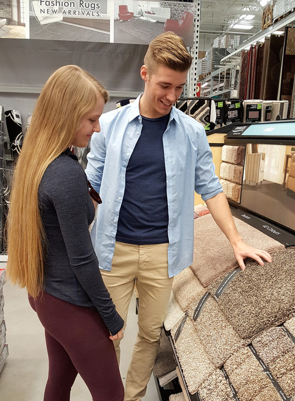 a couple looking at rug samples